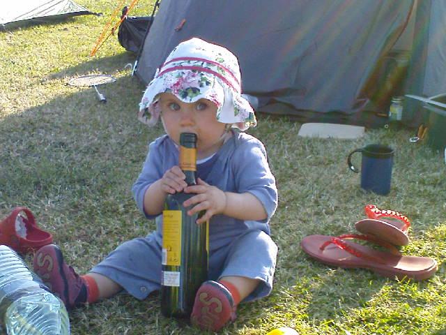Carla with an (empty) wine bottle